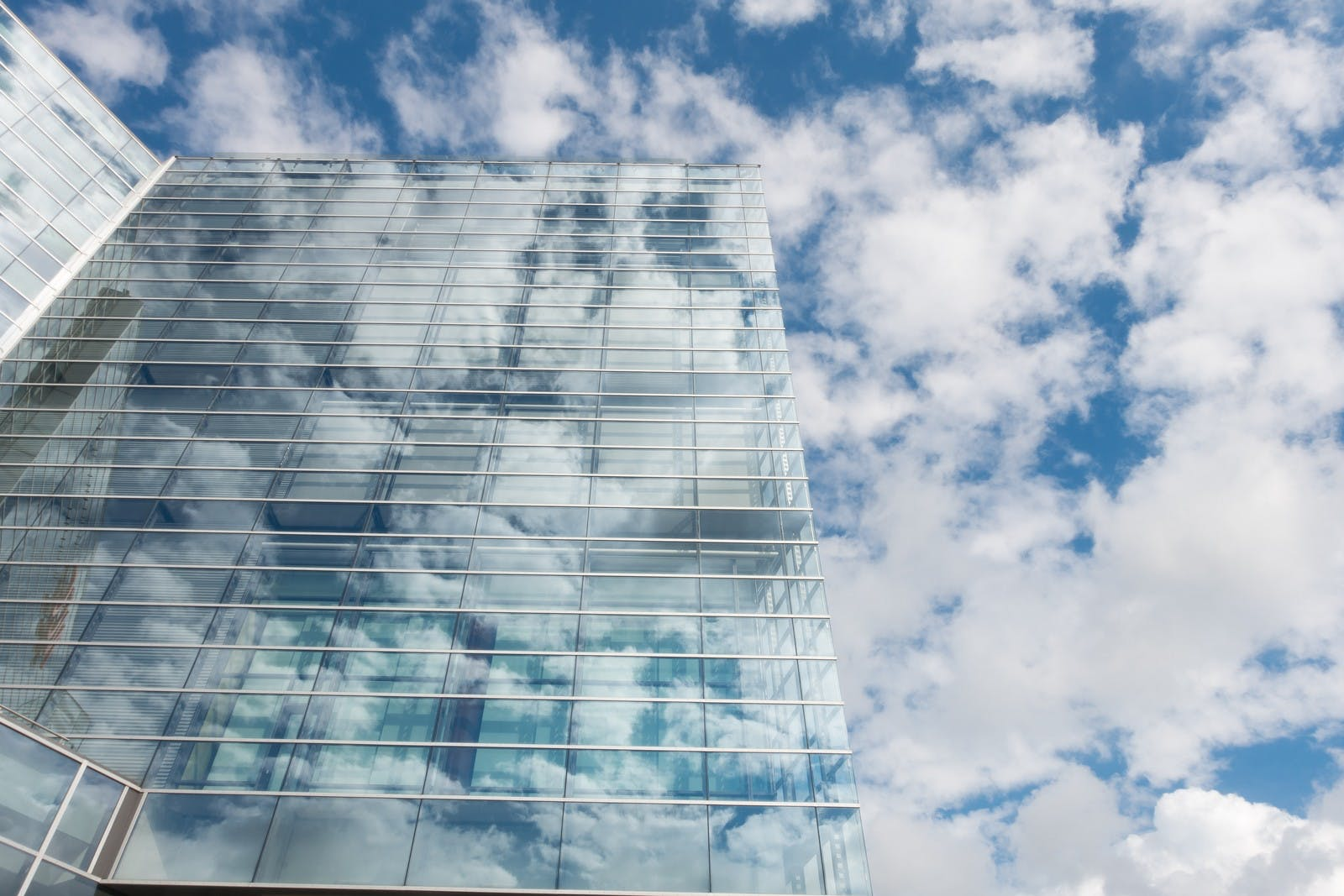 Office Building Exterior Reflecting Clouds
