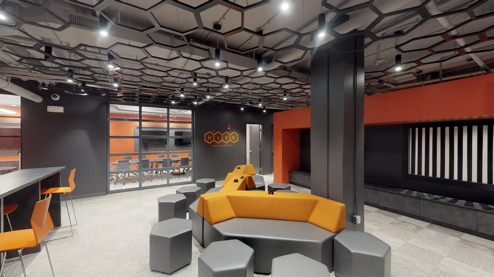 The Hive Office Space modern open concept office with hexagonal geometry themes
